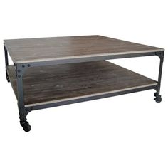 Versatile and Unique Industrial Coffee Table. This charming Coffee table combines elements of distressed wood and metalwork. It features metal wheel casters for legs with rivet-edge metal supports. This creates the perfect coffee table for a contempt