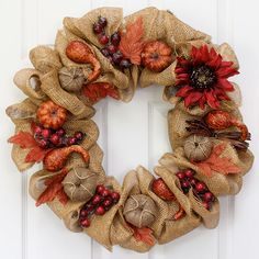 Burlap, golden leaves, and pumpkins may come to mind when you think of fall. So why not add them all to a straw wreath? To see how Erin made this wreath, go to her blog, How To Nest For Less.