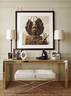 Mirrored Console Table Decor. A large black-and-white portrait of an African Maasai warrior serves as an eye-catching focal point.