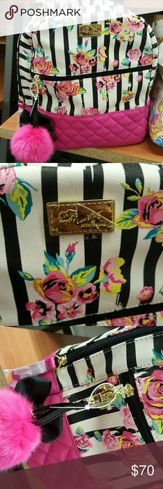 Betsy Johnson Floral Backpack Beautiful floral backpack Leather like material includes Fluffy ball keychain  Large front zipper pocket . Betsey Johnson Bags Backpacks