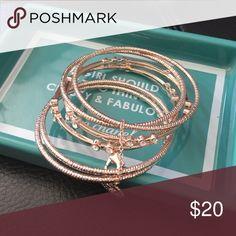 6 rose goldtone bangles w/ clear stone detail 6 bangles rose goldtone with clear stones. Jessica Simpson Jewelry Bracelets