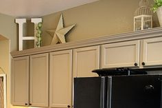 Ideas for above my cabinets!  I love the star and the letter.  I could use a M for Melvin or spell out EAT!