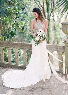 modern wedding dress with openback details. Featured Photographer: Sophie Epton
