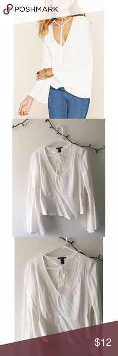bell-sleeve white blouse bell-sleeve white blouse. tie neck. zipper on the side. never worn. a little see-through. goes perfect with jeans! Forever 21 Tops Blouses