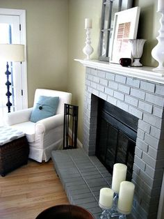 out with the brick in with the gray, concrete masonry, fireplaces mantels, home decor, painting, I picked a medium shade of gray to compliment our tan walls