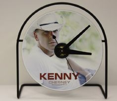 "Save $50.00 on KENNY CHESNEY PICTURE CD CLOCK THAT PLAYS THE SONG ""DON'T BLINK""; only $49.95"