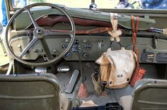 WWII Jeep MB interior with a M1 Garand in a universal rifle rack a M36 musette bag and a M17 binocular case.
