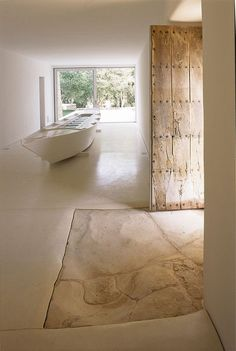 HOUSE RENOVATION IN MALLORCA... great to keep parts of the original home as focal points of interest and history