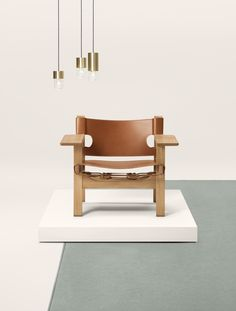 Tan leather armchair - the Spanish chair in tan leather by Børge Mogensen. Danish design classic from 1958. Available at Fredericia. photo by Wichmann + Bendtsen Photography.