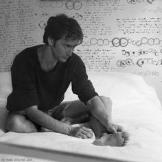 David Tennant - at first glance, it looked like Gallifreyan behind him