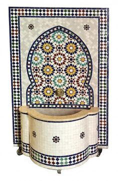 Moroccan handmade Zellige Fountain , wall water fountain , Moroccan Mosaic Fountain , Garden and Indoor outdoor decor , Moroccan Mosaic Our mosaic fountains come from the Moroccan city of Fés, which is known for its mosaic craftsmanship.The ornaments of the fountain surface are assembled from individual mosaic pieces of different shape, color and size in a complex and fascinating procedure.Whether as a room or garden fountain, our mosaic fountains are suitable for indoor as well as outdoor use a Moroccan Pendant Light, Brass Pendant Light, Moroccan Lanterns, Moroccan Decor, Moroccan Style, Moroccan Bedroom, Moroccan Interiors, Outdoor Walls, Indoor Outdoor