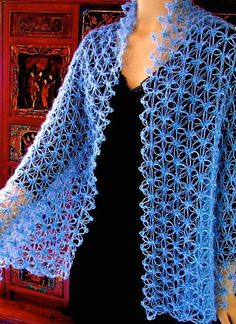 This love knot crochet pattern is updated with a stitch diagram and more, as of September The original edition appeared in the Summer 2013 issue of Interweave Crochet magazine. Crochet Jacket, Crochet Cardigan, Crochet Scarves, Crochet Shawl, Crochet Clothes, Crochet Stitches, Crochet Baby, Free Crochet, Knit Crochet