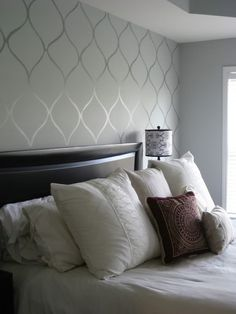 All walls in grey, one feature wall with shimmer stencil across it