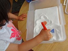 Salt box discoveries: Stimulate early learning by hiding objects (e.g., numbers, letters, colors, shapes) in a salt box for your children to find || Gift of Curiosity