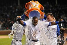Alfonso Soriano #12 of the Chicago Cubs receives a Gatorade bath from teammates Reed Johnson #5 (L) and Jeff Baker #3 after hitting a game-winning RBI single scoring Tony Campana #1 during the 10th inning against the St. Louis Cardinals at Wrigley Field in Chicago, Illinois. The Cubs defeated the Cardinals 3-2 in 10 innings. (Photo by Brian Kersey/Getty Images)