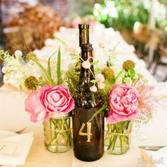 wine bottle centerpiece with table # on it | Wine Bottle and Mason Jar Centerpieces