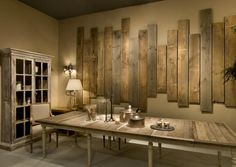 Pallet wall - this is really interesting. you could add pictures on top and make it very cool looking.