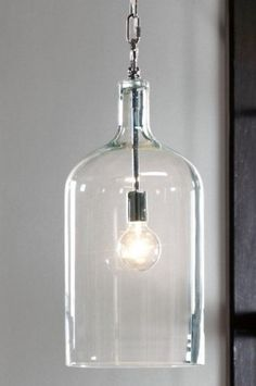 DIY??  I've seen the mason jars, but what about wine bottles or fancy glass bottles?   Capri 1-Light Pendant  Price: $149.00 |   I'm completely obsessed with this eye-catching pendant light. The clear finish and exposed steel chain create the perfect slick look.