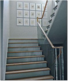Rick and Lorna's Langley, BC Home-In the stairwell, a grid of 15 framed drawings and prints, found at a flea market near Provence, adds top...