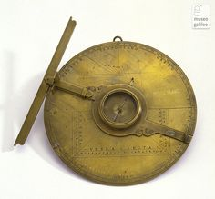 Surveying compass Surveying compass consisting of a disk whose circumference is divided into eight 45° sectors carrying the names of the winds. 17TH CENTURY