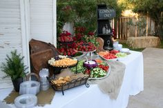 Notice the use of a saddle bag as a prop for the food station. There is always a way to incorporate props into your wedding style.