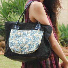 A classic shaped tote with spacious interiors and leather bottom to keep the bag sturdy.  $79