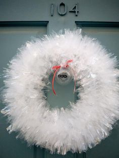 Plastic bag wreath ~ O my gosh! This was the HOT thing to make in the late 60's. We had them hanging in our house for several years. Not sure if this is the same method or not. We shaped wire hangers, untwisted the tip and wove on strips of plastic cute from dry cleaner bags.  Recycle/upcylce is nothing new. love it must try! #ecrafty
