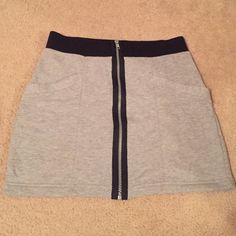 Gray Zip Mini Skirt Gray and black zip front mini skirt. Has two pockets on the front. Super soft and feels like sweatpants. Size M from Forever 21. Forever 21 Skirts Mini