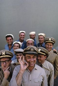 """McHale's Navy"" (back row, left to right) Edson Stroll, John Wright, Carl Ballantine, Gary Vinson (middle row, left to right) Billy Sands, Gavin MacLeod, Bob Hastings (front row, left to right) Joe Flynn, Yoshio Yoda, Ernest Borgnine, Tim Conway"