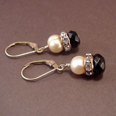 Earrings of faceted black onyx, golden cream fresh water pearls with copper and crystal accents. Ear wire made from 14 kt GF 30th Anniversary Gifts, Water Pearls, Black Onyx, Fresh Water, Copper, Pearl Earrings, Wire, Beaded Bracelets, Cream