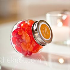 Monogrammed jars filled with pink and orange jelly beans gave guests a sweet reminder of the evening.
