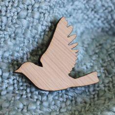 Flying bird wood brooch. $12.00, via Etsy.