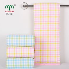 Little Girl favorite big towels,one side like muslin material,soft and note fade.the other side is cotton terry,keep it more absorbent than usual,the plaid pattern is popular in the marketing and the pink/blue is more like in the children world.