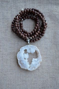 Geode Slice Pendant on Wooden Bead Long Necklace with Sterling Silver Nuggets // www.etsy.com/shop/hannahclairejewelry