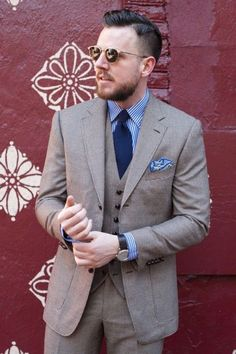 Shop this look for $324:  http://lookastic.com/men/looks/dress-shirt-and-blazer-and-waistcoat-and-tie-and-pocket-square-and-dress-pants/2185  — White and Blue Vertical Striped Dress Shirt  — Grey Wool Blazer  — Grey Waistcoat  — Navy Tie  — Light Blue Pocket Square  — Grey Wool Dress Pants