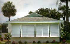 Bahama shutters create that coastal living style for your home while providing shade and most important, easy to close hurricane protection from an impending storm. Types Of Shutters, Diy Shutters, Interior Shutters, Bermuda Shutters, Bahama Shutters, California Shutters, Hurricane Shutters, Classic Architecture, Types Of Houses