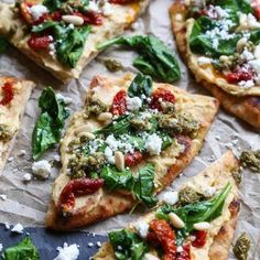 A beautiful appetizer to celebrate National Hummus Day – hummus flatbread with sun-dried tomatoes, feta, spinach, pine nuts, and pesto sauce makes for an easy-to-prepare snack. This post is s…