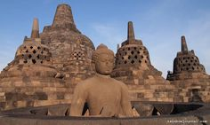 Buddha Blessings.  After watching the sunrise we explored the massive Borobudur.  The three middle levels of Borobudur represent theformless world. Here the platforms are circular no reliefs on the walls and has a more open feel. There are a total 72 stupas on these levels each housing a Buddha.  Read more at rainbowjournal.com  #travel #borobudur #indonesia #buddha Surakarta, Borobudur, Monument Valley, The Good Place, Buddha, Sunrise, Blessed, Explore, Adventure