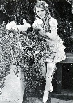Mary Pickford, silent film actress with bunnies