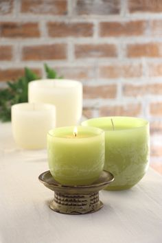 Timber Luminaries- Glowing luminaries in a Timber texture perfect for outside entertaining shown on our ceramic pedestal tray in antique green. www.vancekitira.com Green Candles, Pillar Candles, Pedestal, Tray, Entertaining, Ceramics, Texture, Antique, Creative