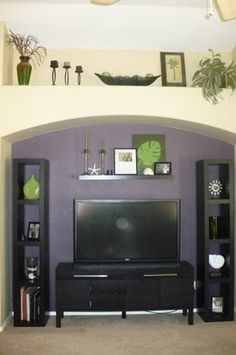 decorations above new tv in nook | Shelves and tv stand from Ikea. Green vase from Kohl's, leaf artwork ...