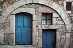 Portes i finestres / Doors and windows (by @adosc) #door #window #blue #stone #house