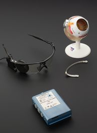 It's early days, but this bionic eye is restoring people's vision. The camera sends signals to an implant on the person's retina, helping him or her distinguish shapes in black and white.    Find out more: http://www.sciencemuseum.org.uk/objects/loans/E2010-45-1.aspx