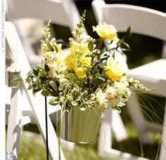 Shepherd hook with galvanized bucket and flowers... maybe use planted flowers so you can use them at home after the wedding!