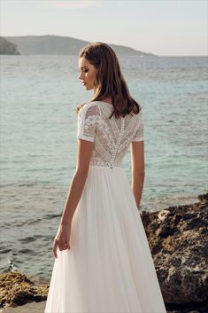 Sensual short-sleeved wedding dress for delicate and romantic brides. A charming lace bodice and a delicate chiffon multilayered skirt perfectly complete this wedding look Lace Wedding Dress With Sleeves, Wedding Dress Chiffon, Short Sleeved Wedding Dress, Bridal Gowns, Wedding Gowns, The Bride, Short Sleeve Dresses, Dresses With Sleeves, The Dress
