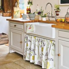 Farm sink with cleverly concealed under-sink area.  Photo: Spike Powell/IPC Images | thisoldhouse.com | from 28 Thrifty Ways to Customize Your Kitchen