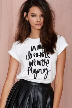 Your dreams of being a fly girl are about to come true. The In My Dreams Tee is made in white cotton jersey and features front graphic text