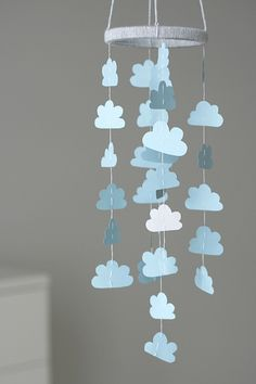 Could cover clouds with paper / fabric so all slightly different. Need white string or wool? Hoop could be covered card - mod podge to seal.
