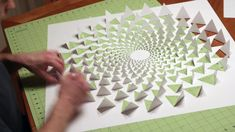 optical illusion wall art made using one sheet of paper. Create this intricate optical illusion mandala wall art using templates offered at . Cut and fold one sheet of paper for an intricate wall paper art project. Used in this video: Black Origami Art Mural, Art Mural 3d, Paper Crafts Origami, Diy Origami, Paper Wall Art, 3d Wall Art, Paper Artwork, Paper Art Projects, Clay Projects