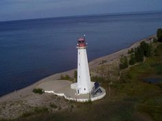 Long Point Light (ON), The 1843 lighthouse was replaced in 1916 because the shifting sands of Long Point had left it dangerously close to the water; it became a hazard and was burned down in 1929. The second order Fresnel lens from the 1843 lighthouse is now on display at the Port Burwell Marine Museum. The present lighthouse was originally 102 feet tall; it was shortened as part of a renovation in the 1980s. The lighthouse stands today within the Long Point Biosphere Reserve.